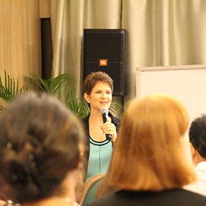Brenda Bence speaking to audience